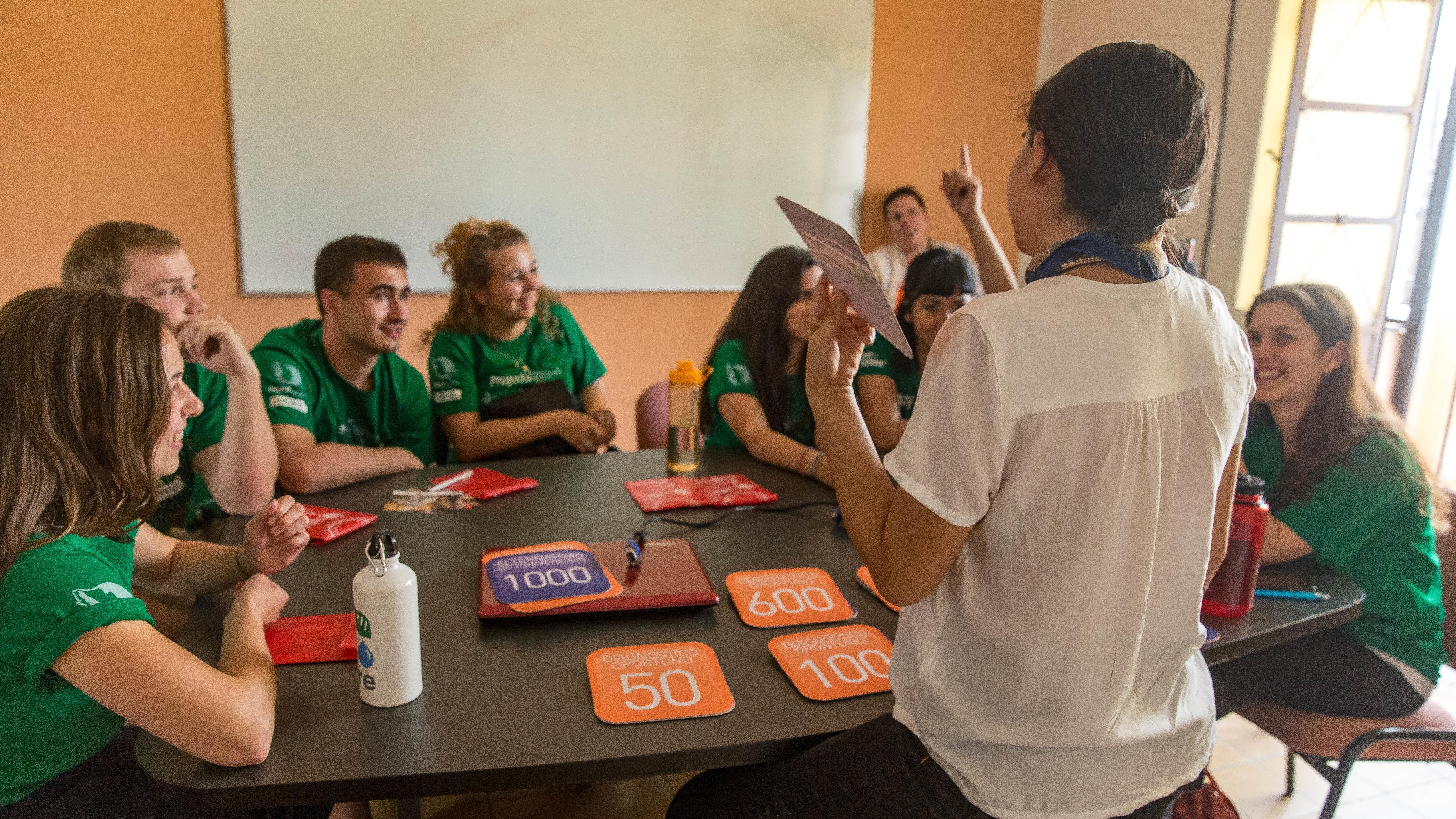 Projects Abroad interns playing a medical diagnosis game during their physiotherapy internship in Mexico.